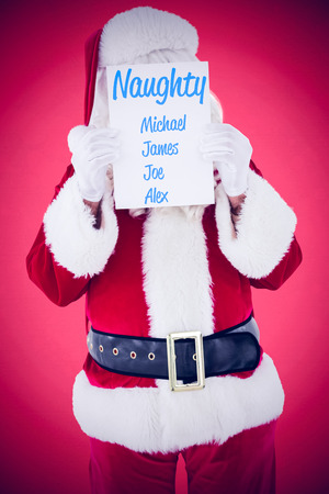 naughty or nice: Santa claus presenting card  against red background Stock Photo