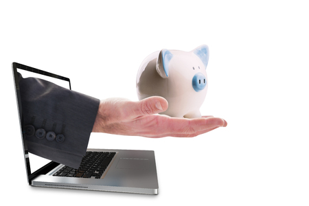 hand out: Businessman holding hand out in presentation against piggy bank