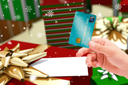 wrapped up: World credit card against colourful wrapped up christmas gifts