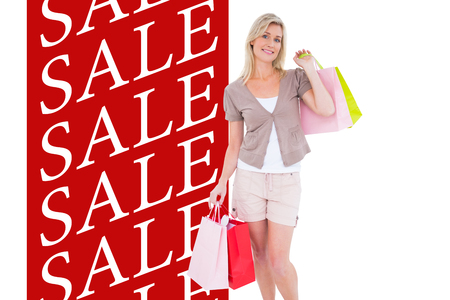 gift spending: Happy blonde with shopping bags against sale advertisement Stock Photo