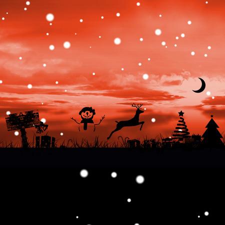 red sky: Christmas scene silhouette against red sky over grass