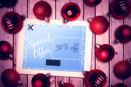 christmas savings: Tablet pc against christmas baubles