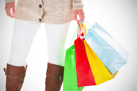 designer bag: A Woman with multiple shopping bags Stock Photo