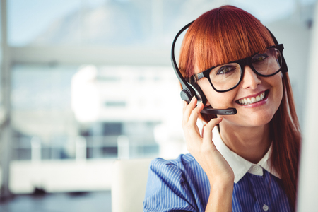 call: Attractive hipster woman with headset in her office