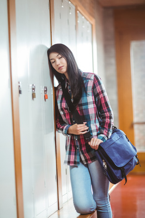 restless: Restless student standing next the locker at the university Stock Photo