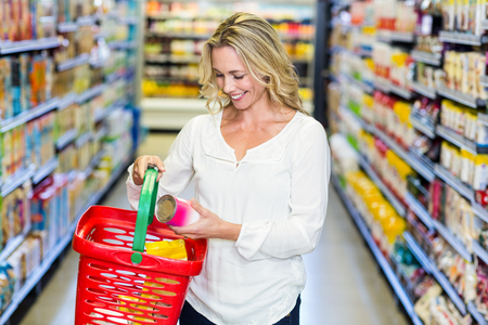 buying: Woman buying food in supermarket