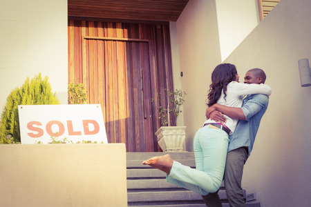 Portrait of happy couple after buying new house Stock fotó
