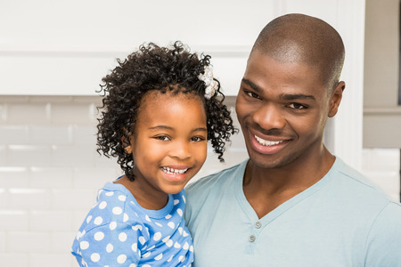 black person: Father and daughter in the kitchen at home