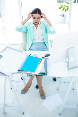 aggravated: Stressed out business woman at the desk in work