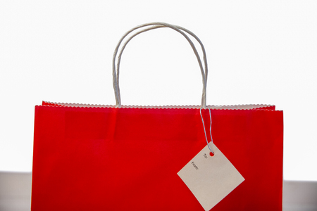 gift bag: Red shopping gift bag with tag shot in studio