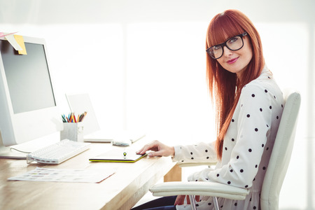 graphics tablet: Attractive hipster woman using graphics tablet in her office