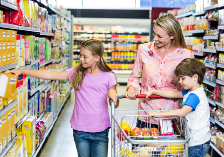 shopping list: Mother and kids at the supermarket together