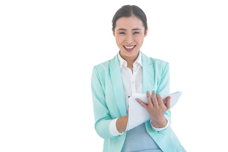 holding notes: Smiling businesswoman holding notes against white background