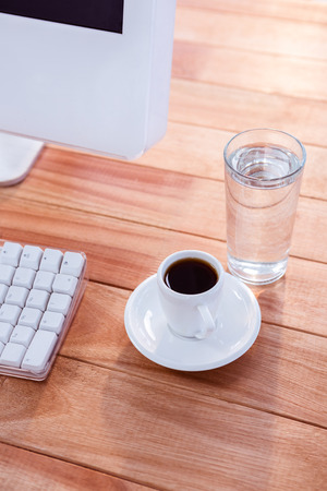 electronic organiser: Close up view of a cup of coffee on wooden desk Stock Photo