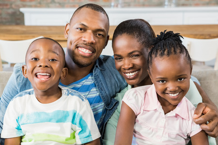 black: Happy family relaxing on the couch in living room