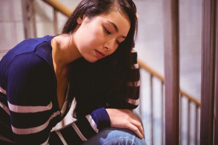 beautiful sad: Worried student sitting in hallway at the university Stock Photo