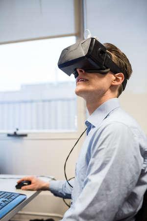 rift: Businessman using oculus rift headset in the office