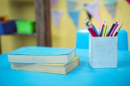 playschool: Pencils and books on table in playschool