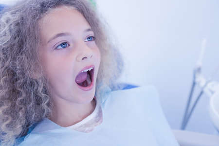 dental fear: Portrait of a young patient at the dental clinic