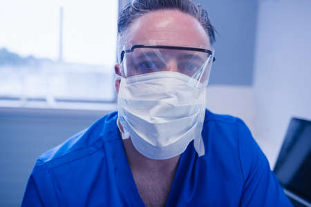 surgical mask: Portrait of male dentist in surgical mask