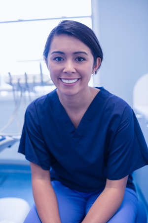 surgical gloves: Portrait of happy female dentist with surgical gloves posing LANG_EVOIMAGES