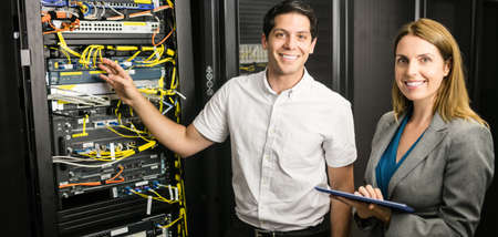 network server: Team of technicians working together at the data centre