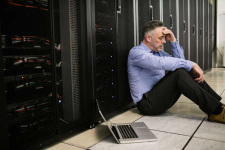 gloominess: Technician feeling the pressure in server room at the data centre