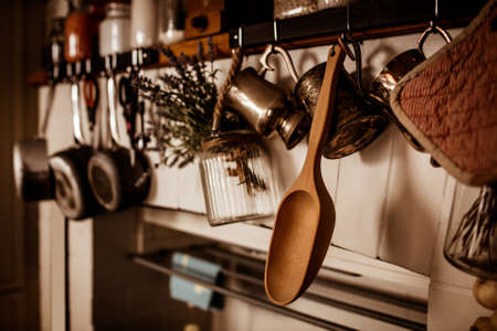 domiciles: Kitchen utensils hanging on wall in a stylish home