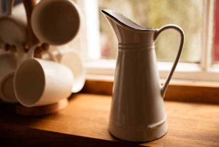 window sill: Jug on window sill in kitchen in a stylish home LANG_EVOIMAGES