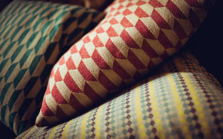 homey: Close up view of cushion with geometric pattern at home LANG_EVOIMAGES