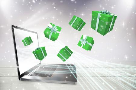 fiestas electronicas: Green presents against laptop