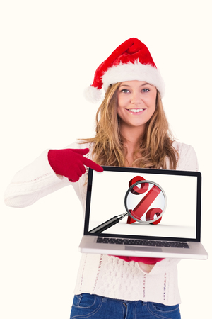 regression: Festive blonde pointing to laptop against white background with vignette