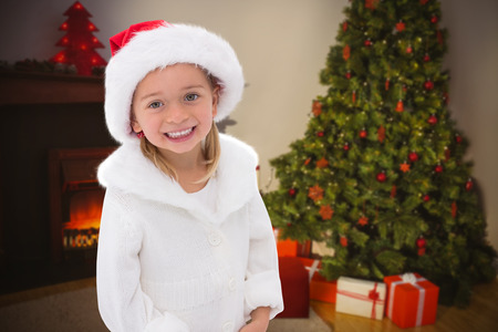 wearing santa hat: Composite image of cute little girl wearing santa hat