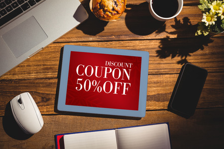 books on a wooden surface: View of a desk against sale advertisement Stock Photo