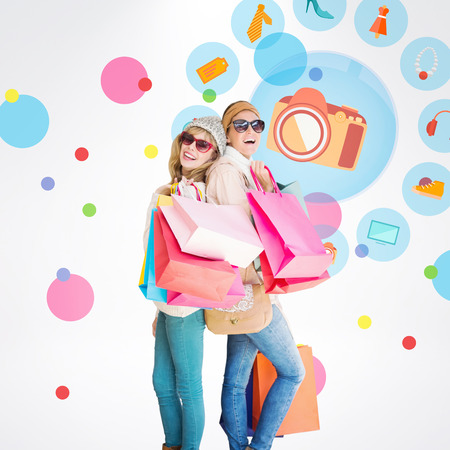 jewlery: Beautiful women holding shopping bags looking at camera  against dot pattern