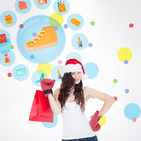 christmas perfume: Beauty brunette in boxing gloves with shopping bag against dot pattern