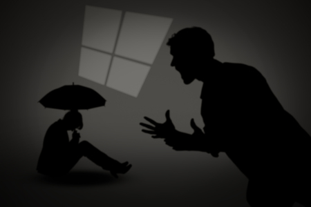 sheltering: Businesswoman with umbrella against silhouette of shouting man