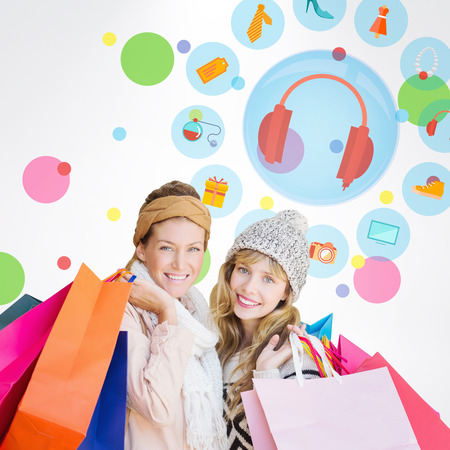 jewlery: Smiling women looking at camera with shopping bags  against dot pattern