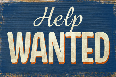 help: A Vintage coloured help wanted sign