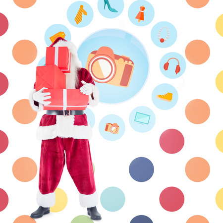jewlery: Santa carrying gifts against colorful polka dot pattern