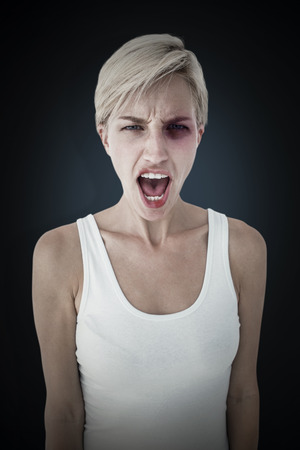 angry blonde: Angry blonde woman screaming  against blue background with vignette Stock Photo