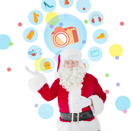 hand out: Happy santa with his hand out against dot pattern Stock Photo