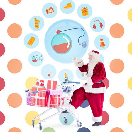 polka dot pattern: Santa delivering gifts from cart against colorful polka dot pattern