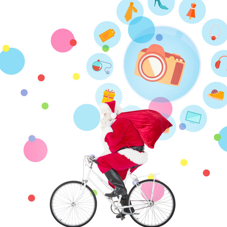 jewlery: Santa claus delivering gifts with bicycle against dot pattern Stock Photo