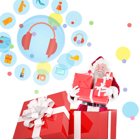 jewlery: Santa standing in large gift against dot pattern