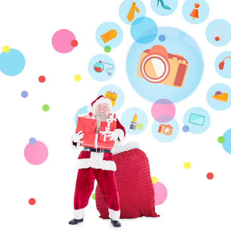 jewlery: Santa holding pile of gifts against dot pattern
