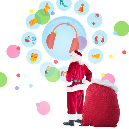 jewlery: Happy santa with sack of gifts against dot pattern