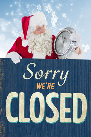 Santa holding a clock and sign against vintage closed sign