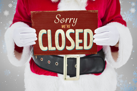 merry time: Mid section of santa claus holding page against vintage closed sign