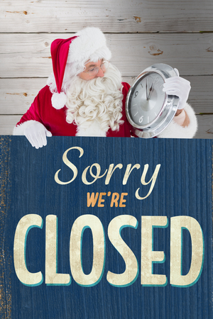shop sign: Santa holding a clock and sign against vintage closed sign